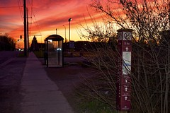 sunset, sault ste. marie, ontario (twurdemann) Tags: sunset ontario canada clouds spring busstop sidewalk saultstemarie northernontario hydroline northernavenue nikcolorefex saultcollege tonalcontrast 03ndsoftgrad hubtrail fujixe1 xf1855mm leeseven5 johnrowswell