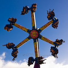The Claw 11 (C & R Driver-Burgess) Tags: park blue red orange woman man feet girl yellow beard fun lights amusement ride legs brother uncle spin daughter young twist fair drop teen niece cap sit theme held flashing harness whirl strapped flung