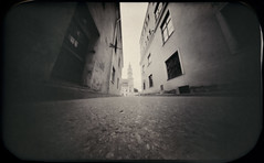 Daugirdo street, Kaunas Old Town (batuda) Tags: pinhole obscura stenope analogue tin altoids paper kodak polymax 6x9 bw blackandwhite wide wideangle kaunas oldtown city street cityhall ground sky building architecture cityscape outdoor perspective monochrome d76
