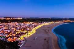 Nazare at dusk (Kuba Abramowicz) Tags: nazare portugal europe european eu europa dusk twilight blue hour bluehour sea ocean atlantic water waterfront long exposure nikon night nikkor nikor 2470 town city cityscape cityline funicular view scenery scenic vista light lights yellow color colors colour colours colorful composition coast sky skyline waves d610