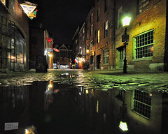 Quiet Wharf Street (Corey Templeton) Tags: city winter urban reflection night portland puddle march alley streetlight quiet waterfront angle wide maine newengland sigma gritty cobblestones handheld 1020mm oldport 2012 wharfstreet 382012