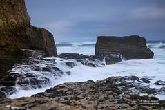 Pounded By The Surf (Darvin Atkeson) Tags: ocean california sea cliff santacruz seascape beach landscape waterfall stream surf waves pacific sandy crack foam vista davenport tidal tides seas darvin atkeson darv liquidmoonlightcom