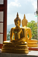 Buddha in the Window (2) (Ursula in Aus (Away)) Tags: window statue thailand temple gold buddha buddhist buddhism wat seated   prachuapkhirikhan bangsaphan thongchai  earthasia  totallythailand   khaothongchai watthangsai