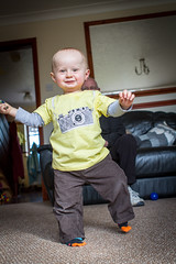 I'm Walking!! (s0ulsurfing) Tags: camera boy portrait baby cute smile face yellow canon fun happy eyes toddler infant babies faces head expression availablelight ambientlight innocent expressions adorable tshirt ears william isleofwight 7d quizzical innocence ambient relaxed infants oneyearold firststeps minime 2012 fofinho pleased toddling s0ulsurfing familyuk gettyimagesportraits