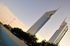 Tilted view of the Emirates Towers. (XavierParis) Tags: winter sky cloud arquitetura architecture skyscraper sunrise buildings arquitectura nikon dubai afternoon hiver uae ciel cielo twintowers invierno puestadesol xavier nuage emiratestowers xavi  nube hernandez coucherdesoleil sheikhzayedroad iberica burjdubai toursjumelles   d700 xavierhernandez jumeirahinternationalgroup emiratsarabeunis  burjkhalifa torresjemelas xyber75 xavierhernandeziberica