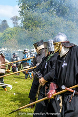 [2014-04-19@15.04.13a] (Untempered Photography) Tags: history costume fight smoke helmet battle medieval weapon sword knight combat armour reenactment skirmish combatant chainmail spear canonef50mmf14 perioddress polearm platearmour poleweapon mailarmour untemperedeye canoneos5dmkiii untemperedeyephotography glastonburymedievalfayre2014