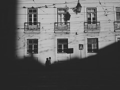 7pm (Tng Neva Sleep) Tags: street old light sunset shadow people white house black building portugal girl wire europe afternoon lisboa lisbon streetphotography dramatic tram southern shade network cinematic streetshot alcantara
