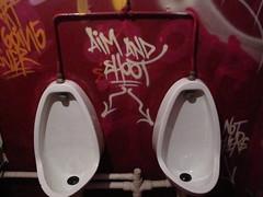 Aim and shoot (duncan) Tags: streetart shoreditch urinals