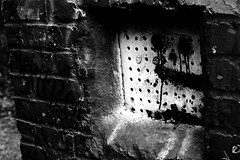 Brick Face (aye_candy) Tags: blackandwhite white ny newyork black brick face outdoors grate graffiti paint letters longisland brickwall vandalism babylon defaced 2012 southards southardspond