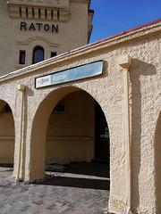 Raton Amtrak (Night Owl City) Tags: railroad usa 3 newmexico station sign raton platform amtrak depot southwestchief atsf missionrevival colfaxcounty pointlessarrow