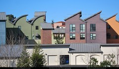 Playful Roof Forms (Mike Bowermaster Photography) Tags: california usa silhouette skyline colorful backalley garage salinas telephoto edge montereycounty centralcoast safeway flattened westcoast playful configuration architecturalphotography metalroof aligned mixeduse clerestory multifamily shedroof roofforms edgeprofile mikebowermasterphotography canons95 economicalconstruction buildingbeyond playfulroofforms profileline