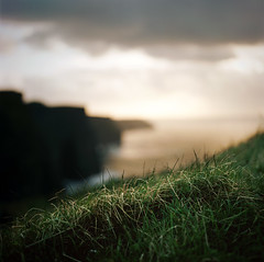 be here now. (manyfires) Tags: ocean ireland sunset sea green film grass mediumformat square landscape golden glow shoreline eire cliffs hasselblad cliffsofmoher atlanticocean countyclare raylamontagne beherenow hasselblad500cm