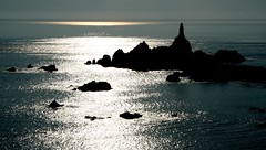 Shimmering (snowyturner) Tags: light sea sunlight lighthouse contrast rocks jersey ripples channelislands englishchannel shimmering lamanche corbiere stbrelade