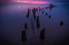 Remnants (rseidel3) Tags: morning lighthouse lake beach water clouds photoshop sunrise pier nikon colorful purple lakemichigan tokina bluehour evanston lightroom 1116mm d7000