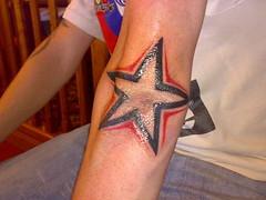 glowing star tattoo on elbow (tattoos_addict) Tags: tattoo star elbow glowing startattoo