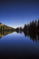 Lower Cathedral Lake moonset, Yosemite NP CA (arbabi) Tags: california usa moon reflection nature america forest sunrise reflections landscape nationalpark granite yosemitenationalpark wilderness sierranevada mariposacounty johnmuirtrail seanarbabi lowercathedrallake