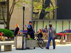 Hit the road, Jack.... (Renee Rendler-Kaplan) Tags: city people sunlight chicago men sunshine bicycle canon reflections outside outdoors spring women downtown sitting gesturing may sit thumb seated officer automobiles waterbottle policeman daleycenter chicagoillinois chicagoist 2016 chicagoreader peoplewalking frommycarwindow peoplesitting hittheroadjack reneerendlerkaplan canonpowershotsx530hs