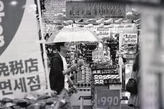 Asia in Ueno (Gemini st.) Tags: street film rain tokyo cosina voigtlander bessa r3a xp2super400 heliarclassic75mmf18