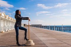 looking at the horizon (mt.matumi) Tags: sea woman sun smile donna mare gorgeous sole modella ombrellone stivali sensetion mtmatumi
