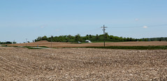Kame  Urbana Township, Champaign County, Ohio (Pythaglio) Tags: road county blue trees ohio sky house field grass landscape corn farm hill utility farmland urbana poles champaign geology mound bushes township stubble kame plowed glacial geomorphology landform cultivated