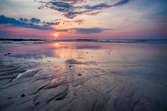 LBI - Sunrise (DJawZ) Tags: ocean morning sunlight color reflection clouds sunrise sand rocks waves atlantic sunsetwx
