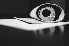 Yoga mat is on the floor black and white image (CreativePhotoTeam.com) Tags: light stilllife white color sport yoga closeup modern train carpet wooden healthy floor exercise bright body object lifestyle towel rubber bodybuilding equipment indoors mat health meditating yogi strong leisure strength meditation practice relaxation workout fitness gym timer liquid weight tool thick aerobics pilates physical gymnastic rolled laminate wellness yogamat accessory