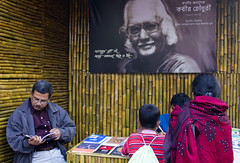 A Reader (Pagan Eyes) Tags: man book reader candid stall fair dhaka bd bangladesh bookfair bookstall dhakauniversity banglaacademy ekusheybookfair