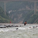 Boatman rests in middle of Shennong Stream