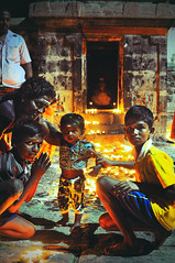 Indian children pray in the temple at the feast of shiva (Zhenya bakanovaAlex Grabchilev) Tags: portrait people india night feast children religious temple indian religion hindu hinduism murti