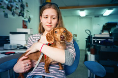 "Lauren & Strudel in ""The Mecca"" (mat4226) Tags: street ohio red dog macro cute lauren green film 35mm puppy that eyes nw angle northwest kodak 28mm wide adorable rangefinder wideangle olympus ps dachshund imagine oh pointandshoot 100 xa findlay xa4 mecca strudel dapple f35 ektar bagley filmphotography fpp filmisnotdead camerareview ektar100 filmphotographypodcast matmarrash nwoh"