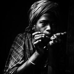 Jaw's Harp (Collin Key) Tags: portrait bw india turban ind jewsharp adivasi chhattisgarh maultrommel muria bastar ghotul collinkey chelik bestportraitsaoi oracosm elitegalleryaoi gondtribes tribalpeopleofindia playingjawsharp ftsmay