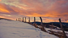 The Border to the Night (M4j4) Tags: pink winter sunset orange snow night clouds fence border pohorje podpohorje
