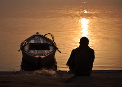The Wait [Explored] (Bhaskar Dutta) Tags: old sun india man water silhouette sunrise river landscape golden boat sand calm varanasi wait motifdchallengewinner gettyimagesmiddleeast yahoo:yourpictures=light gimemay2213