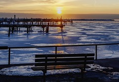 Immediate Seating (MalaneyStuff) Tags: park morning winter sky usa sun lake cold ice weather wisconsin clouds marina sunrise landscape dawn pier frozen niko