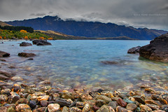 Rocky Shores || LAKE WAKATIPU || QUEENSTOWN (rhyspope) Tags: new mountain lake pope nature water canon landscape island rocks waves south zealand nz queenstown 5d remarkables wakatipu rhys mkii rhyspope