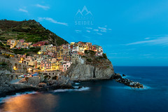 Manarola, Cinque Terre - Italy (Damien Seidel) Tags: travel sunset vacation italy cliff holiday seascape landscape coast town nikon italia amalficoast village cinqueterre bluehour manarola nikond810