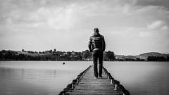 peace of mind (nina_gaisch) Tags: blackandwhite lake man water lago austria see sterreich spring wasser jetty uomo mann hombre steiermark frhling steg brygga sj sterrike leibnitz schwarzweis waldschach