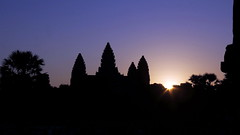 Sun is rising behind Angkor Wat
