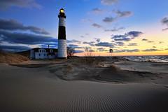 Big Sable Point Lighthouse - Ludington, Michigan (Michigan Nut) Tags: winter sunset sky usa lighthouse beach clouds geotagged sand midwest michigan dune landmark lakemichigan ripples drifting ludingtonstatepark johnmccormick bigsablepointlighthouse michigannutphotography