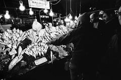 (Kathrinza) Tags: people blackandwhite fish man men film lamp retail night analog turkey evening market sale istanbul analogue bazaar trade bazar canoneoselaniie istanbullovers
