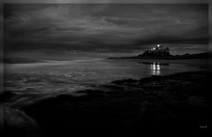 Midnight. (cadvan3) Tags: longexposure shadow sea england sky blackandwhite lighthouse reflection castle beach wet water weather rock stone night clouds reflections dark landscape flow lights twilight lowlight waves darkness britain dusk sony tripod north stormy northsea dslr distance northeast bamburgh a330 damp hightide rockpools seawater bamburghcastle northeastengland bamburghbeach sonya330 cadvan3 davidabedson yahoo:yourpictures=reflections yourpictureswaterv2 yahoo:yourpictures=yourbestphotoof2012 yahoo:yourpictures=england2013 yahoo:yourpictures=coastal yahoo:yourpictures=duskdawn yahoo:yourpictures=powernature