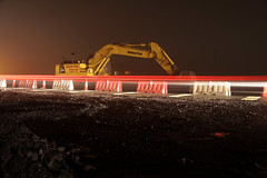Light trail (Mark Quigley - www.markquigley.ie) Tags: road light abandoned car rain weather yellow fog night canon site construction long exposure traffic cone roadworks trail nighttime remote lightrail silhoette digger cones trigger dense 50d wasteside