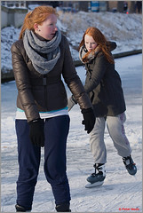 Two sisters (Peter Heuts) Tags: snow ice beautiful sisters hair fun photography canal frozen utrecht bevroren 5 sony sunday skating redhead peter february alpha 5th rood 77 redheads sal zondag 2012 gracht catharijnesingel a77 ijs februari schaatsen haar plezier 70200g heuts winter2012