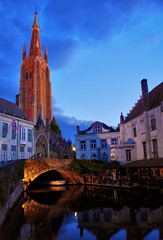The Magic of Bruges (Jeka World Photography) Tags: world city travel blue sky reflection tower history jeff nature rose vertical horizontal architecture night outdoors photography canal europe belgium dusk citylife nopeople symmetry illuminated belltower spire transportation bruges bluehour idyllic thepast perfection distant westflanders tranquilscene traveldestinations colorimage jeffrose buildingexterior nauticalvessel incidentalpeople jekaworldphotography jeffrosephotography kalitharosephotography
