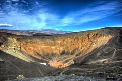 Red Crater in Death Valley N.P. (Daniel J. Mueller) Tags: california park red usa mountains clouds day stones national crater deathvalley hdr 7xp d3s pwpartlycloudy
