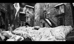 scanno panorama (rob.Forte) Tags: winter blackandwhite bw italy panorama snow storm detail brick texture wall photoshop nikon village urbandecay dramatic photomerge snowing ladder nikkor oldtown borgo abruzzo paese paesino borghi urbanshot scanno manfrottotripod verticalshot nikond90 dramaticblackandwhite hoyand8 silverefexpro topazdetail robertoforte