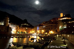 Vernazza By Night (David Morse) Tags: ocean street door wood old city blue trees light red sea sky bw italy orange brown sun moon white house black building tree green tower beach window water glass grass yellow pinetree pine night canon geotagged 350d xt gold grey lights bay boat nationalpark pond sand sandstone rocks europe surf glow sad purple liguria gray ruin wave hills roofs canon350d cinqueterre rebelxt vernazza travertine morse graduatestudent canondigitalrebelxt 2011 coth davidmorse coth5