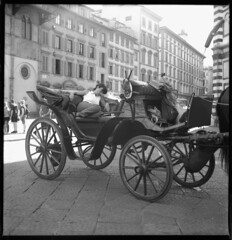 Pisolino in carrozza - Catnap in carriage (Andrea Bosio Photographer) Tags: street city urban blackandwhite bw italy 6x6 film analog canon mediumformat photography eos florence blackwhite strada italia carriage noiretblanc trix streetphotography bn catnap tuscany firenze streetphoto toscana rodinal carrozza bianconero biancoenero pearlriver pisolino trix400 pellicola analogico momentodecisivo 400d canon400d andreabosio iphotographitalian