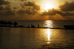 Building sand castles (will668) Tags: sea sun water clouds sunrise reflections earlymorning silhouettes ripples rays sunrays infinitypool