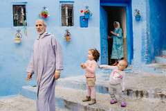 Chefchaouen, Morocco (f.d. walker) Tags: africa street city family blue boy shadow people woman sun sunlight man color men colors girl face kids stairs contrast children point person women child faces candid muslim islam steps colorphotography streetphotography streetportrait clothes morocco pointing chefchaouen bluecity candidphotography